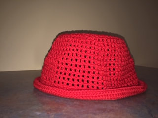 finished one skein red hat in Lion Brand 24/7 yarn from Workbasket Magazine June 1977